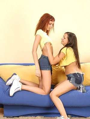 Lesbian Angels Enjoy Being Nasty On The Couch