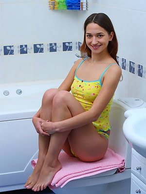Sexy Teen Babe Splits Her Legs In The Bathroom To Have A Good Time And Give You One Too While She Is Masturbating pics