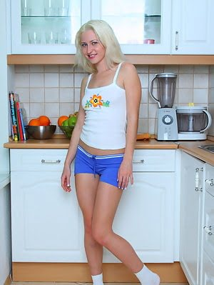 Teen Blonde Babe Serves A Piece Of Pussy Salad In The Kitchen Like No Other As She Strips Her Clothe