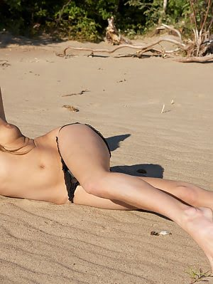 Amazing Dark Haired Teen Beauty Showing Her Naughty Shaved Pussy And Tight Ass On The Beach.