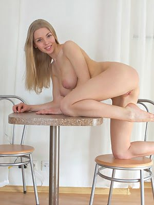 Teen Shows Some Amazing Pussy As She Bends Her Shapely Body Over The Table To Be Able To Show A Bett
