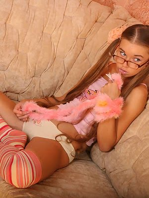 Cute Teenie In High Socks Stripping And Posing On A Couch And Showing Off Her Pink Pussy. Cute pics