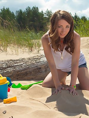 Amazing Brunette Teen Playing Around Naked In The Sand As She Shows Her Hot Booty Shining In The Hot