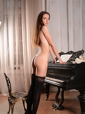 Gorgeous Teen Brunette Gets Naked On Her Piano And Shows The Music Inside Her Soul Through Her Sexy