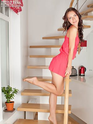 Adorable Long Haired Teen Cutie Taking Off Clothes And Posing In The Nude On The Stairs.