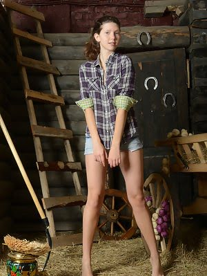Delightful Dark Haired Busty Teen Charmer Taking Off Clothes And Showing Body In The Barn.