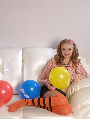 Beautiful Shapely Teen Honey With Colorful Balloons Taking Off Her Clothes On The Sofa. Clothes pics