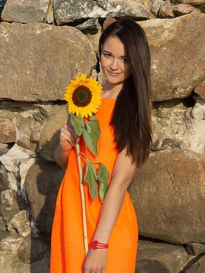 Gorgeous Teen Gets Naked On The Beach And Getting Real Sexy While She Has Nothing But A Sunflower To