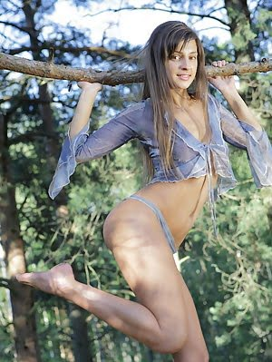 Remarkable Dark Haired Teen Peach Demonstrating The Benefits Of Her Nude Body In The Woods.