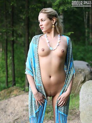 Appetizing Blonde Teen Is Wondering Near Huge Stones In Only One Blue Shawl, Which Hardly Hide Strik Blonde pics