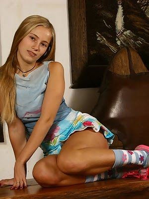 A Blonde Coed Shows Us Her Panties Under Her Mini, Reveals Her Savory Tiny Breasts And Poses Teasing Blonde pics