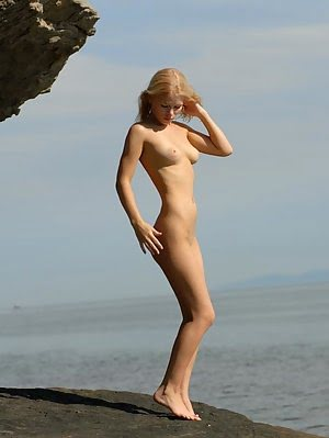 Sweet Exciting Girl With Blonde Hair Posing Her Nudeness Near A Rock On A Sunny Summer Day Posing pics