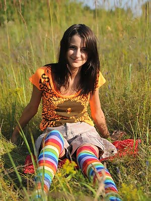 Wonderful Teen Beauty In Long Striped Socks Taking Off Her Clothes Outdoors In The Field. Clothes pics
