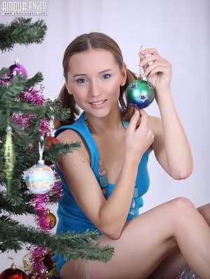 Charming Teenage Girl Strips Nude And Plays With A Christmas Decoration On Her Tight Body.