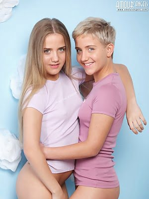 Two Marvelous Shapely Lesbian Teen Chicks Undressing And Posing Together Just In White Socks. Posing pics