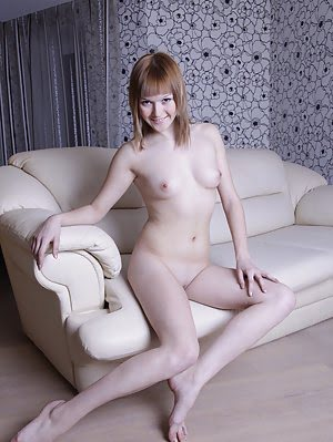 Pretty Teen Beauty With Very White Skin Poses Nude On The Couch And Shows Sexy Body In Heat.