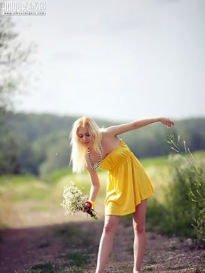 Stunning Blonde Cutie Starts With Posing In Yellow Dress Then Gets Rid Of It Very Willingly. Posing pics