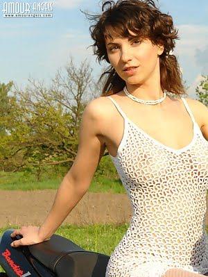 Fresh Brunette Girl Takes Off Her White Dress And Stockings, Posing On A Sport Bike