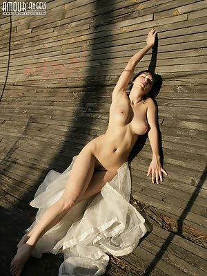Horny Teen Girl Loves Posing Undressed On The Nature So That To Feel Herself One Whole With It.