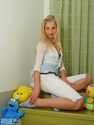 This Blonde Beauty Teen Enjoys Posing Her Most Intimate Parts On Camera With Her Favorite Toy.