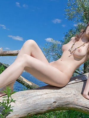Enjoy The Pics Of This Amazing Teen Beauty With Peerless Breasts As She Poses Nude Outdoors.