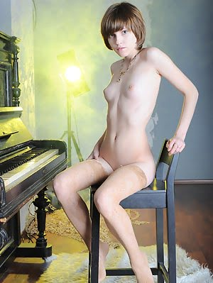 Lovely Teen Girl Poses By The Piano Wearing Nothing But Sheer Stockings On Her Gorgeous Legs. Gorgeous pics