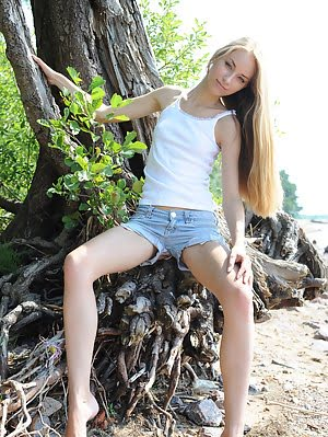 Beautiful Teen Gal With Long Blond Hair And Gorgeous Slim Body Getting Nude In The Forest.