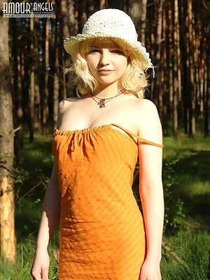 Blonde In A Straw Bonnet Taking Off Her Orange Dress And Stockings To Walk Around Naked