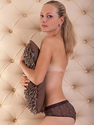 This Amazing Blonde Beauty Splits Her Long Legs In Her Bed To Show Off Her Irresistible Little Tight Irresistible pics