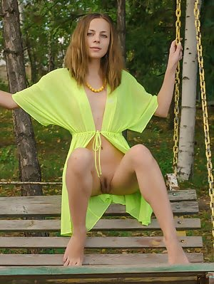 Shapely Brunette Undresses Completely On The Swing, While She Gazes At You, Every Minute Of The Set. Every pics