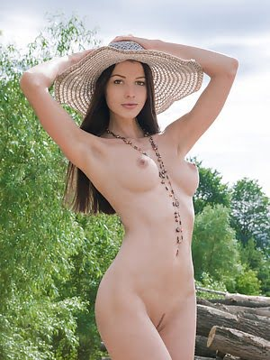 Wonderful Teen In Hat Spreading Legs And Showing Her Exciting Tits And Playful Pussy Outdoors.