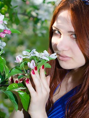 Beautiful Redhead Teen With Bow In Hair Posing Absolutely Naked Among The Flowering Trees. Beautiful pics