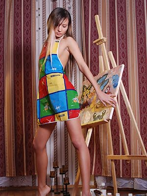 Fascinating Long Haired Painter With A Compelling Look Demonstrating Her Seductive Body.