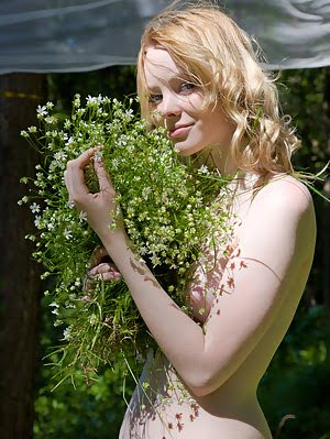 Lovely Sweetheart Shows Off Her Delectable Body Covering It With A Bunch Of Wild Flowers.