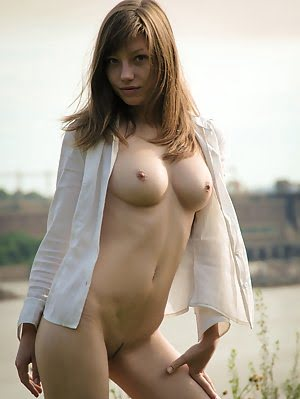 Delectable Girl Demonstrating Splendid Breasts And Groomed Cunt Outdoor Against The Dike. Breasts pics