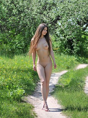 Enchanting Long Haired Teen Beautie Showing Her Perfect Body Outdoors In The Countryside. Showing pics
