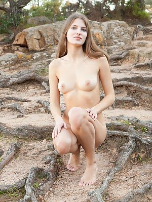 Beautiful Teen Cutie Spreading Legs And Showing Her Tempting Body On The Roots Of Big Tree. Cutie pics