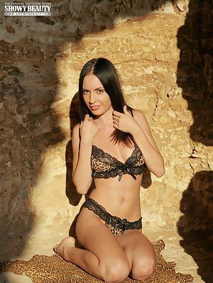 Sensual Images Of A Beautiful Lady Stripping Her Sexy Lingerie And Posing Nude In A Grotto.